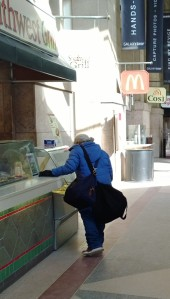 Homeless-woman-in-train-station